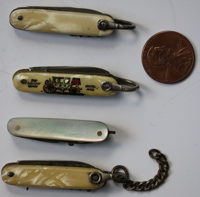 A Collection of Four Miniature Pocket Knives with Corkscrews