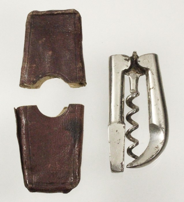 English corkscrew, hoof pick,carriage key,and original etui