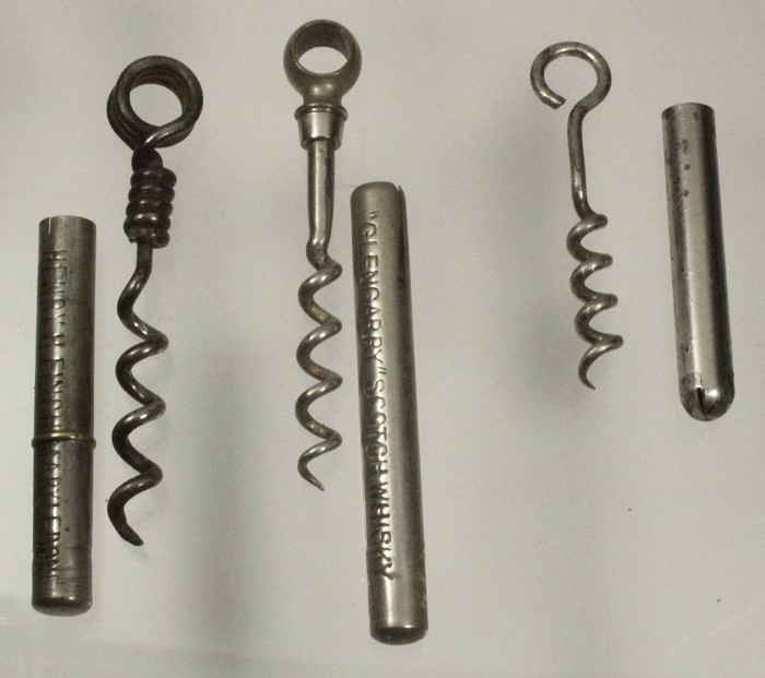 Three pic nic corkscrews, two English and a US one on right