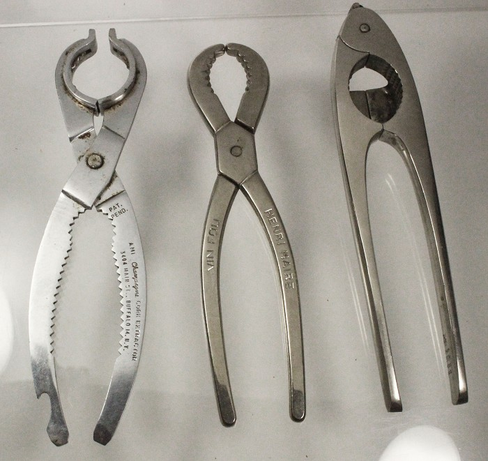 Three champagne openers , AMI Opener and two more