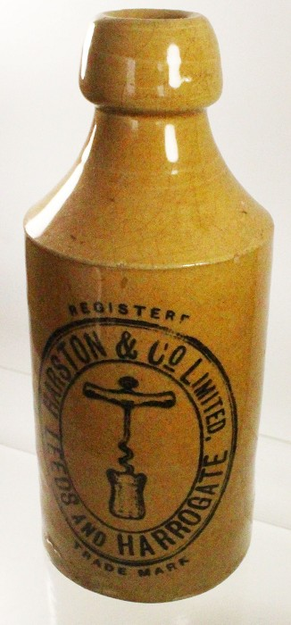 stoneware bottle with advertising and corkscrew