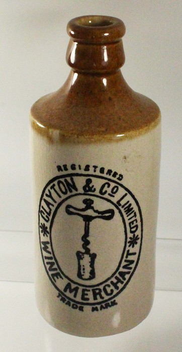 a late 19th century stone jug depicting a corkscrew