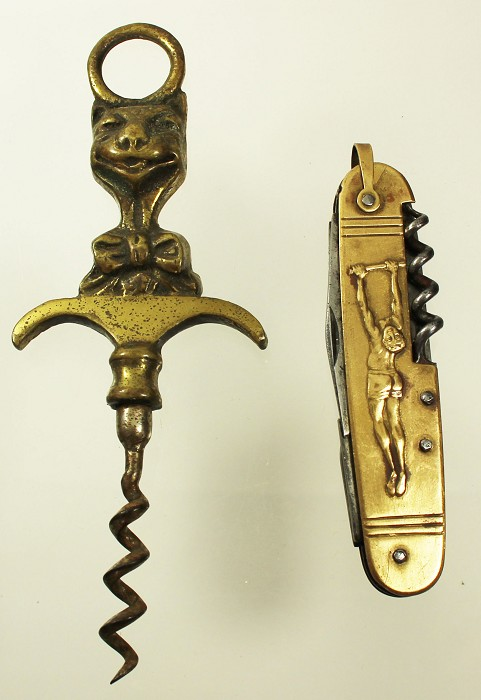 2 corkscrews , a French knife and an English cat
