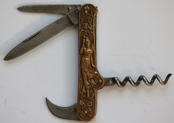 Champagne Knife with Decorated Bronze Scales