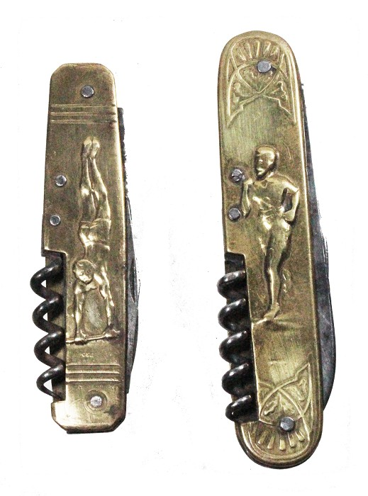 Two French knives, brass scales depicting different sports