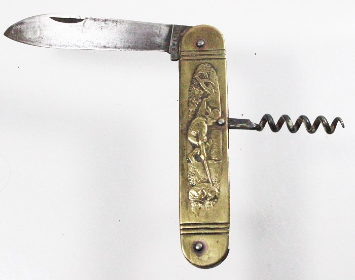 Brass French knife, depicting don't awake a sleeping dog