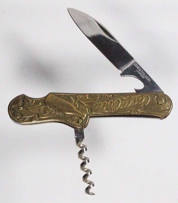 Pocket knife with brass scales advertising COCA COLA