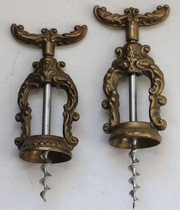 Two Italian Corkscrews with Ornate Frames