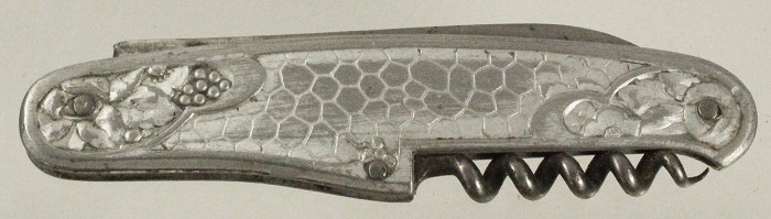 Knife with aluminium scales showing grapes and leaves