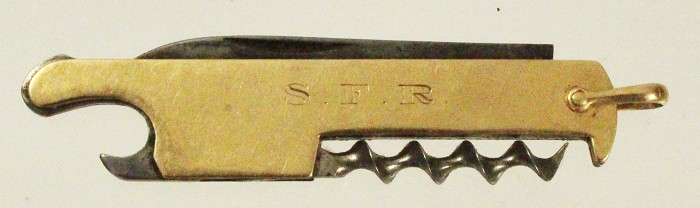 small knife with golden scales marked 14K and owners initial