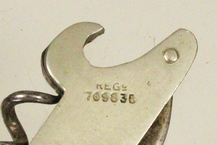British registered knife with cap lifter marked REGd 709835