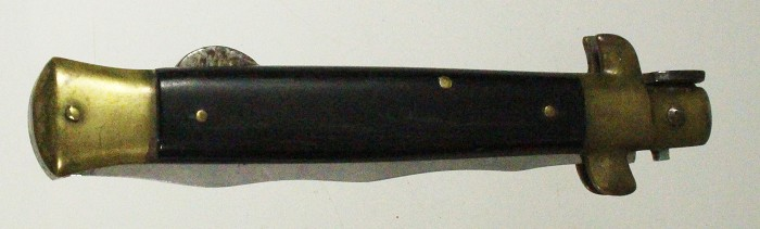 German lock back knife with brass ends and decorative blade