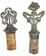 two pewter art nouveau bottle stoppers flowers and butterfly