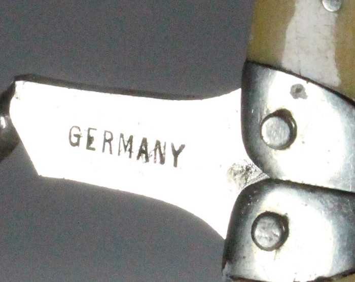 Ladies legs, yellow scales, marked REGISTERED GERMANY