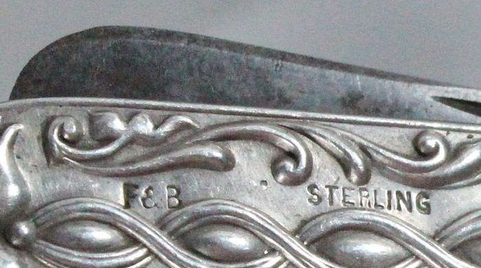 three piece set with silver scales marked F&B (Foster and B)