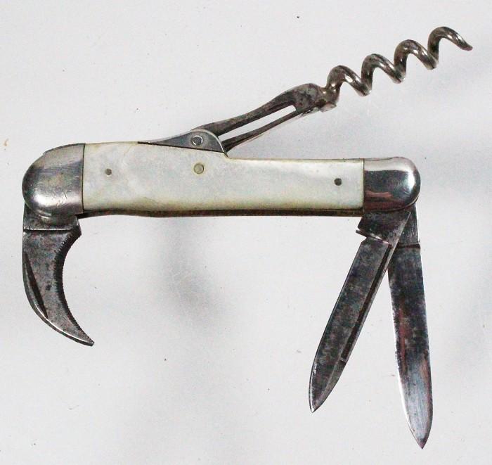 Knife with sliding corkscrew marked G. P. 58529 and KASTOR