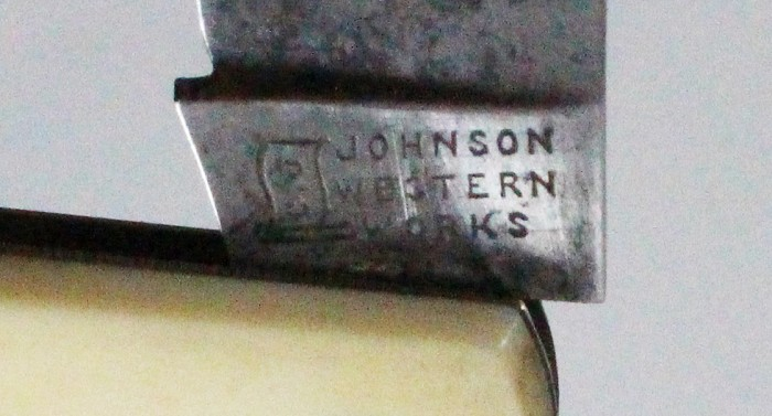 Knife marked CHRISTOPHER JOHNSON WESTERN WORKS and flag