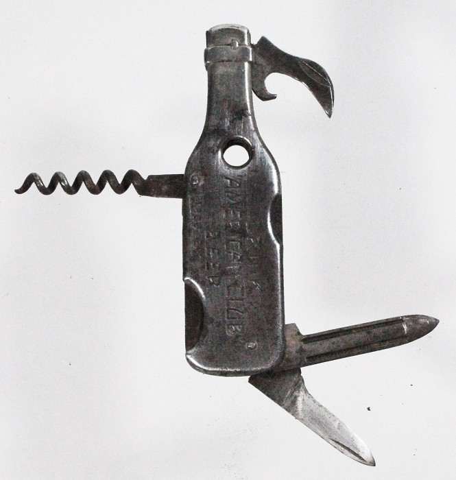 bottle shape with cigar cutter and advertising AMERICAN CLUB