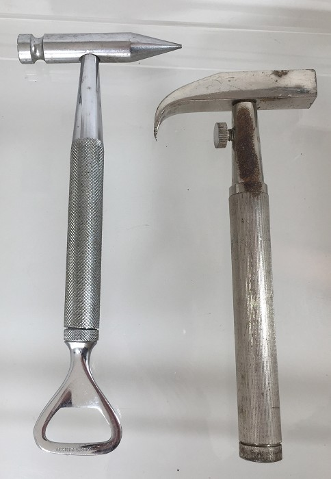 2 hammer tools with instruments