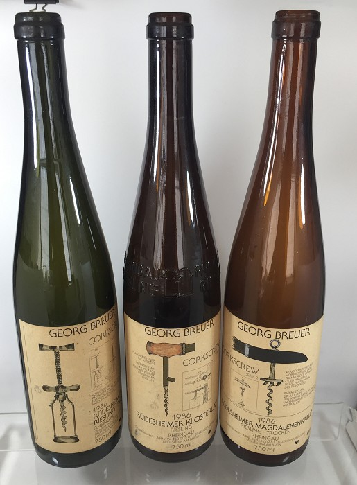6 wine bottles with labels showing German corkscrew patents