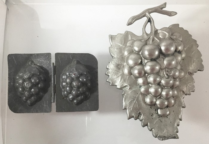 a chocolate mold and a decorative ornament bunch of grapes