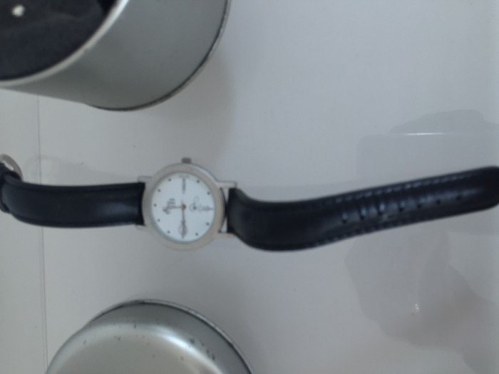 a watch with corkscrew-shaped hands and aluminium box